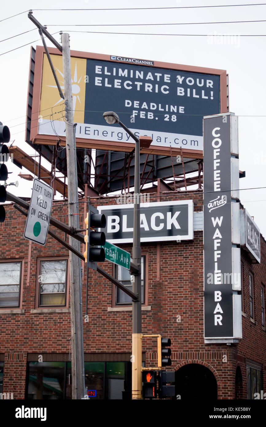Billboard on top of the Black Coffee and Waffle Bar building promoting solar energy and elimination of your electric - Stock Image