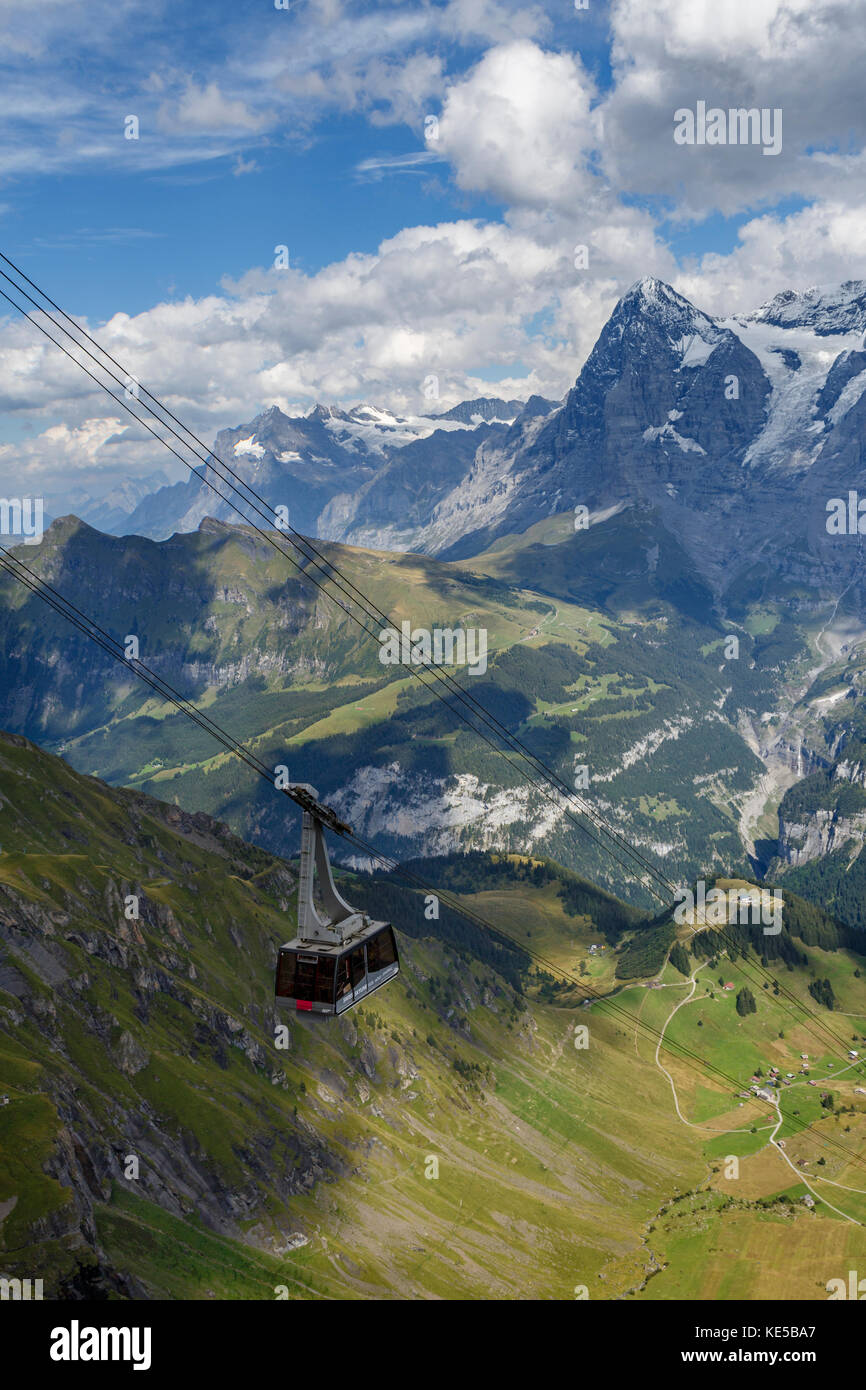 Cablecar arriving at Piz Gloria on the summit of the Schilthorn Mountain, Switzerland. View across the Lauterbrunnen - Stock Image
