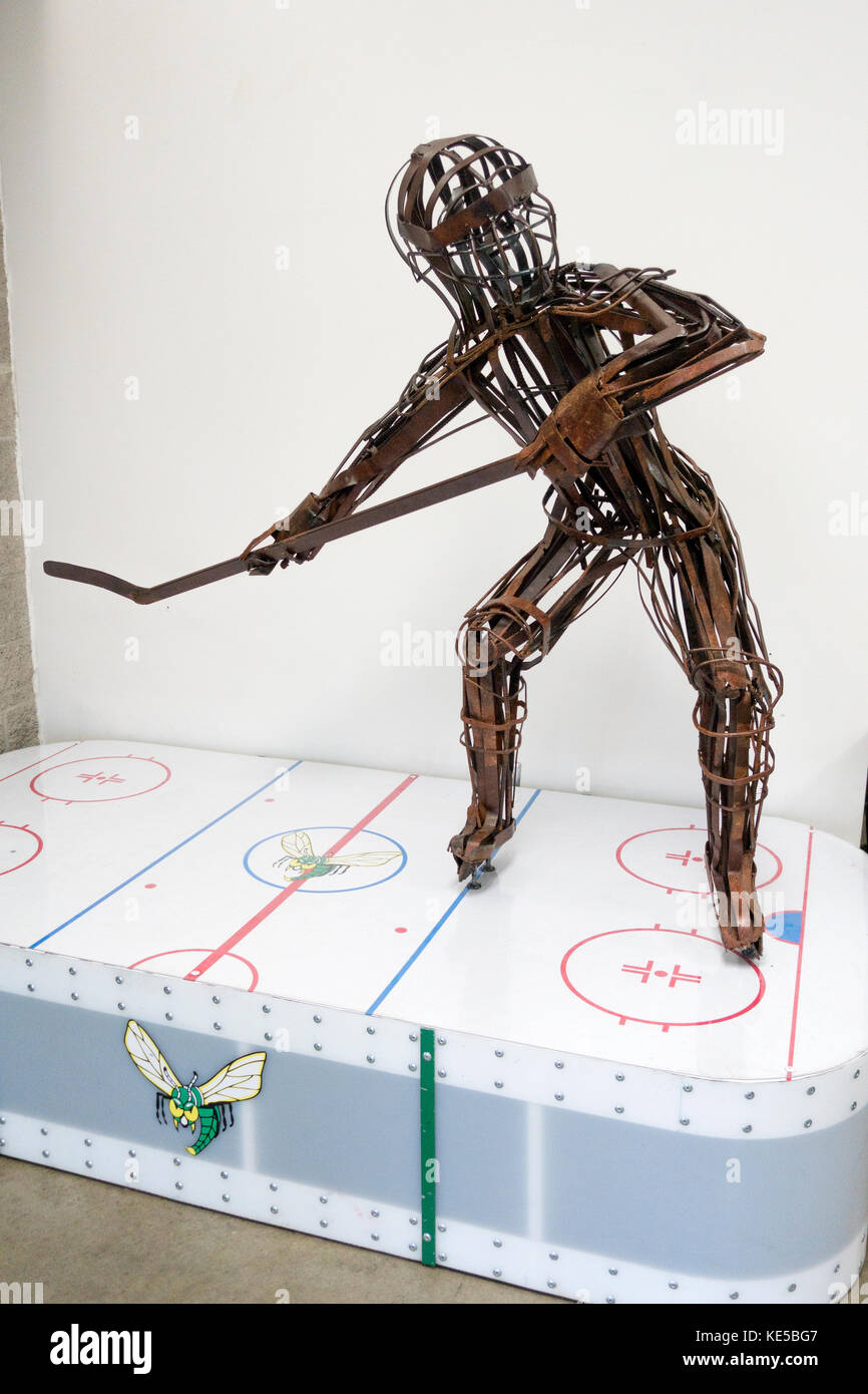 Welded metal hockey sculpture 'Slap Shot' by artist Judd Nelson located in the lobby of the Braemar Hockey - Stock Image