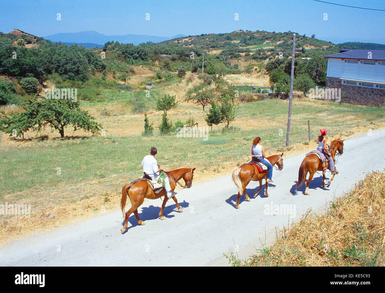 Three people riding horses. Las Medulas, Leon province, Castilla Leon, Spain. - Stock Image