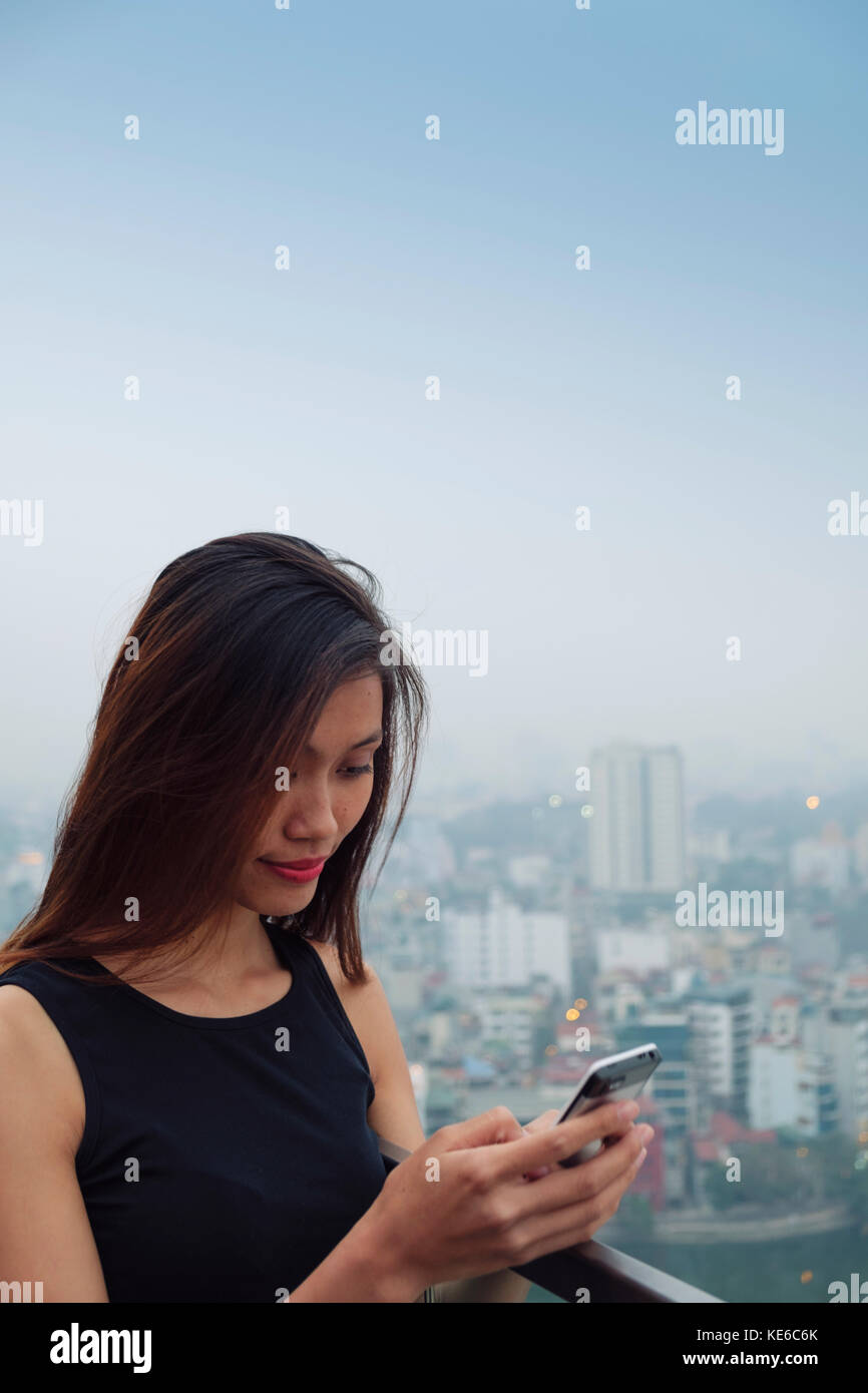 Young Asian Woman on her Cell Phone Stock Photo
