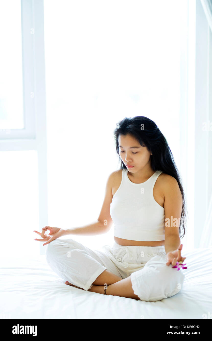 Asian woman in a yoga position Stock Photo