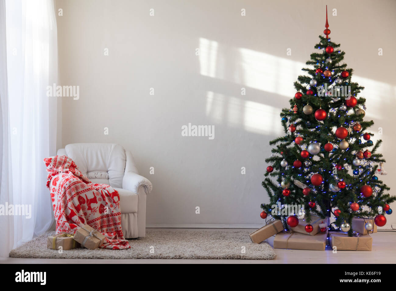 Christmas tree with Christmas gifts in White Hall on Christmas Stock ...