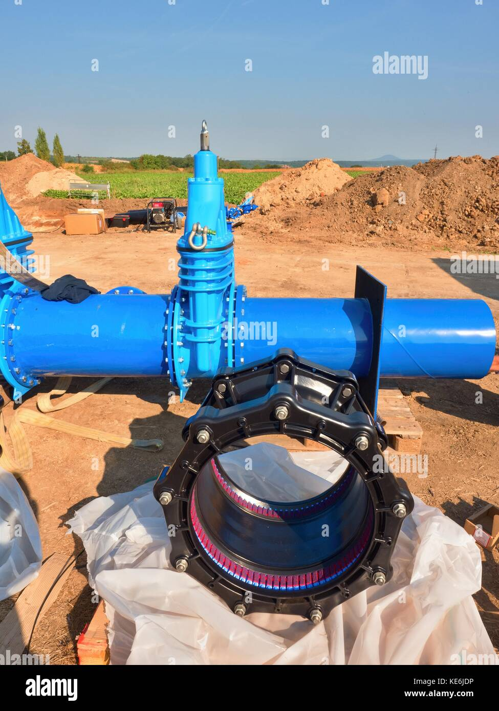 500mm new black waga multi joint unit. 500 mm drink water Gate valve joint with screws and nuts to pipe fitting. - Stock Image