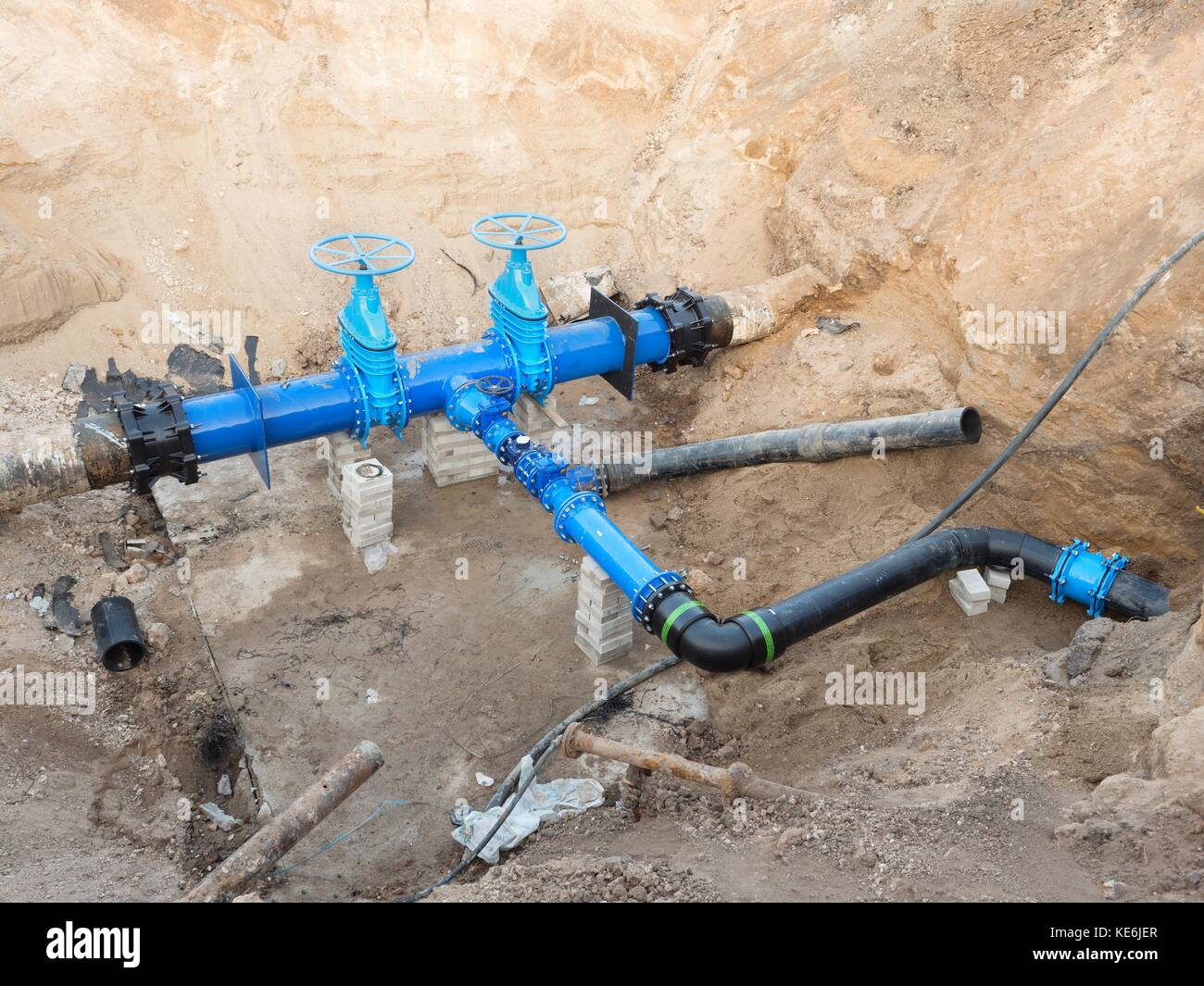 Drink  water pipes joined with new blue Gate valves and new black waga multi joint members. Finished repaired piping - Stock Image