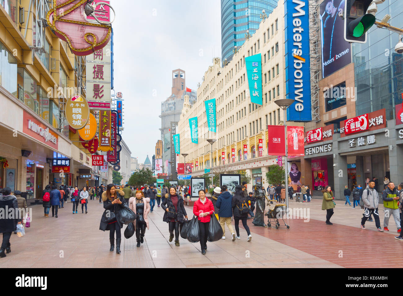 SHANGHAI, CHINA - DEC 28, 2016: People walking on Nanjiing road in Downtown of Shanghai. The area is the main shopping - Stock Image