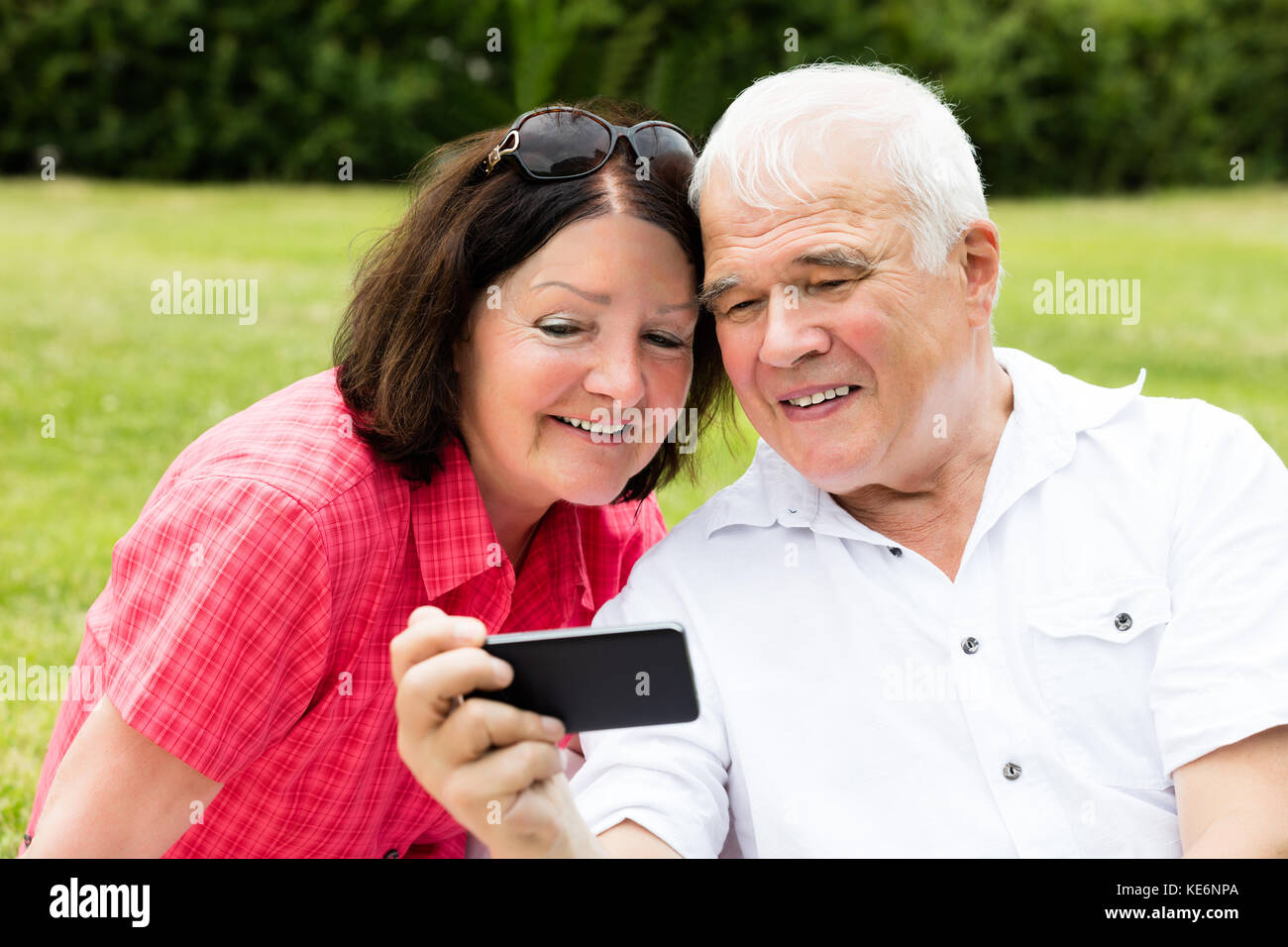 Happy Senior Couple Taking Selfie With Mobile Phone - Stock Image
