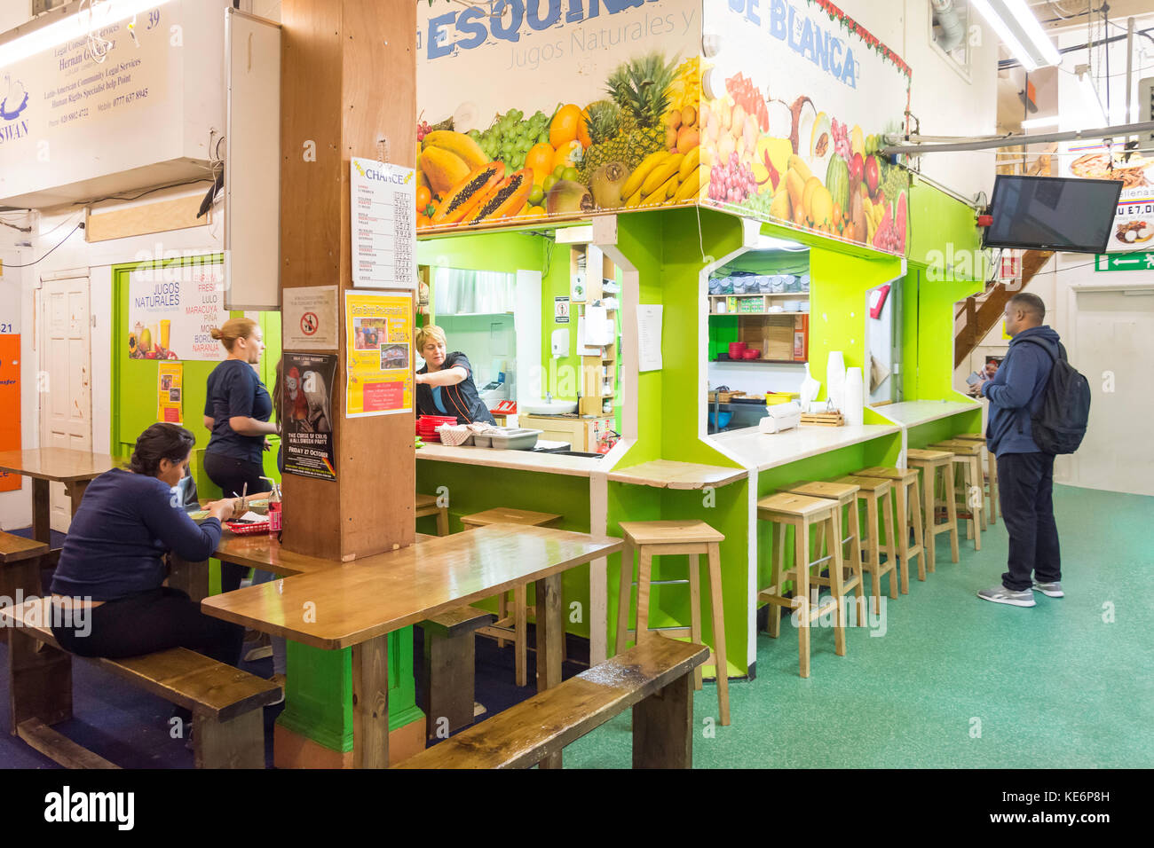 fresh fruit juice stall in Seven Sisters Indoor Market High Road London Borough of Haringey, Greater London, England, - Stock Image