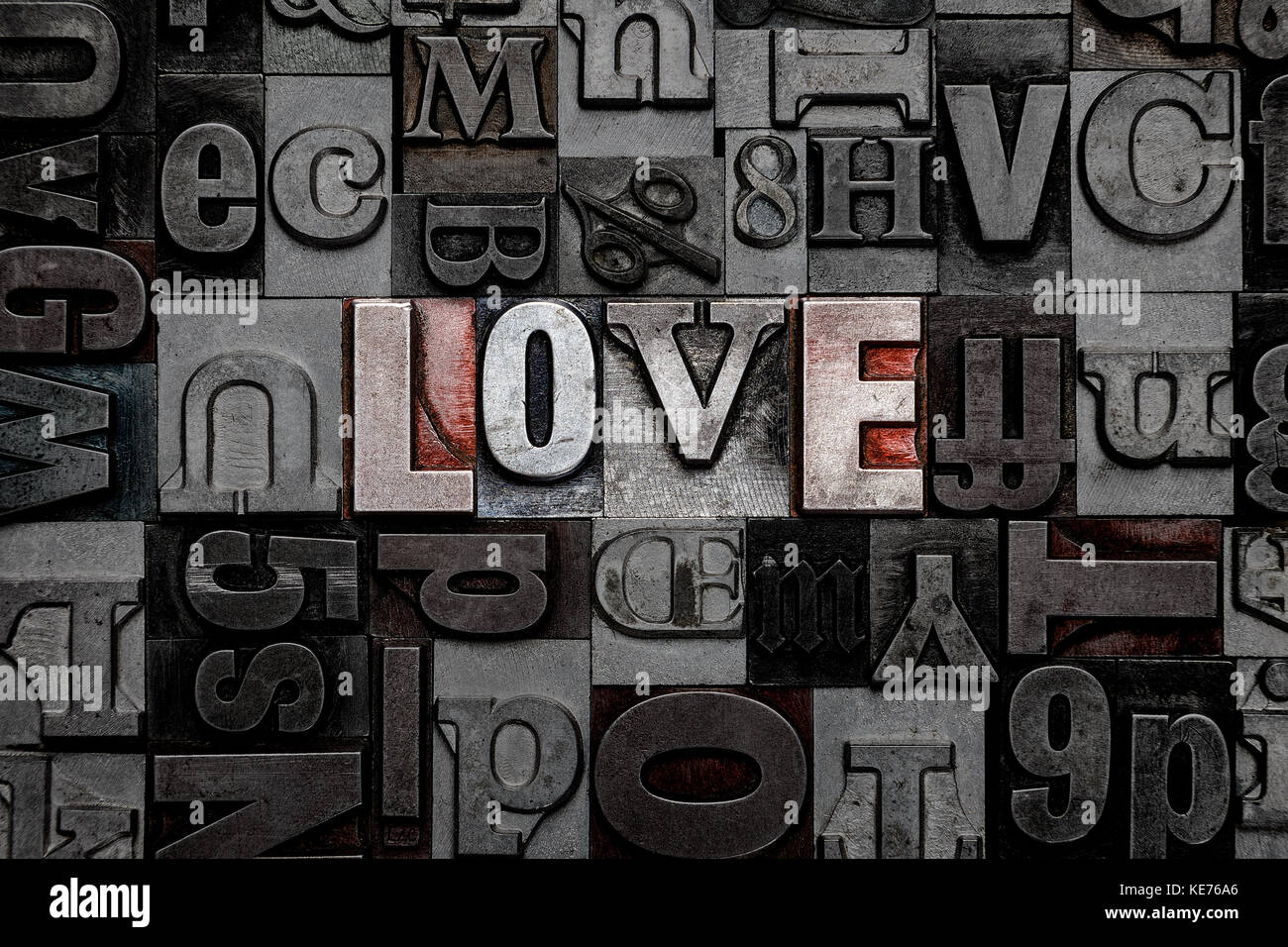 The word Love made from old metal letterpress letters - Stock Image
