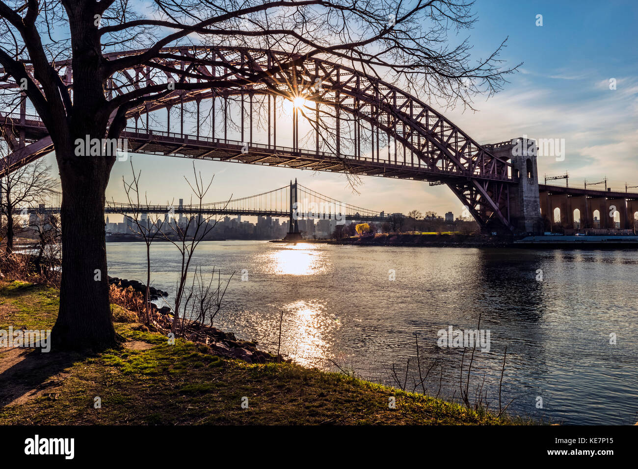 Hell Gate And Rfk Triboro Bridges At Sunset From Ralph Demarco Park; Queens, New York, United States Of America - Stock Image