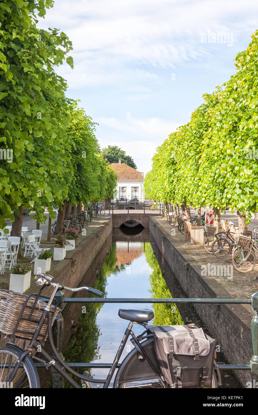 Bicycles parked along the canal at Elburg, The Netherlands - Stock Image