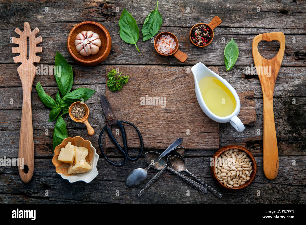 The ingredients for homemade pesto sauce basil, parmesan cheese ,garlic, olive oil , pine nut ,peppercorn and himalayan - Stock Image