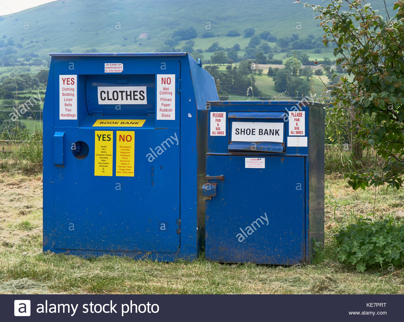 Large blue containers for recycling old books clothes and shoes in Longtown in the golde valley near herefordshire - Stock Image