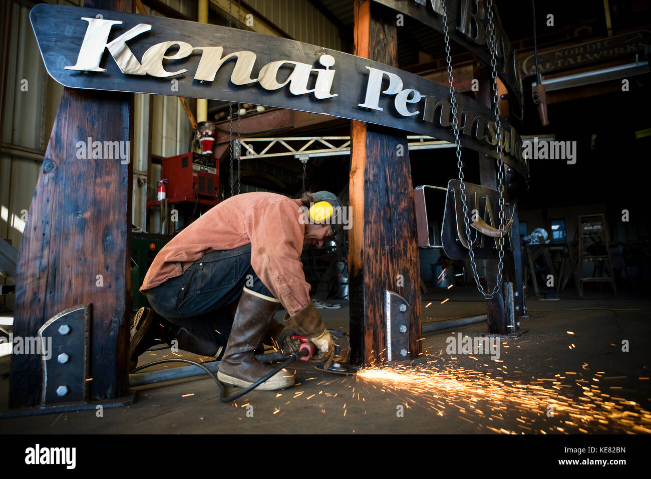 Welder And Metal Work Artist Doug Schwiesow Working On A Custom Sign Designed With A Local Artist For The Kenai - Stock Image