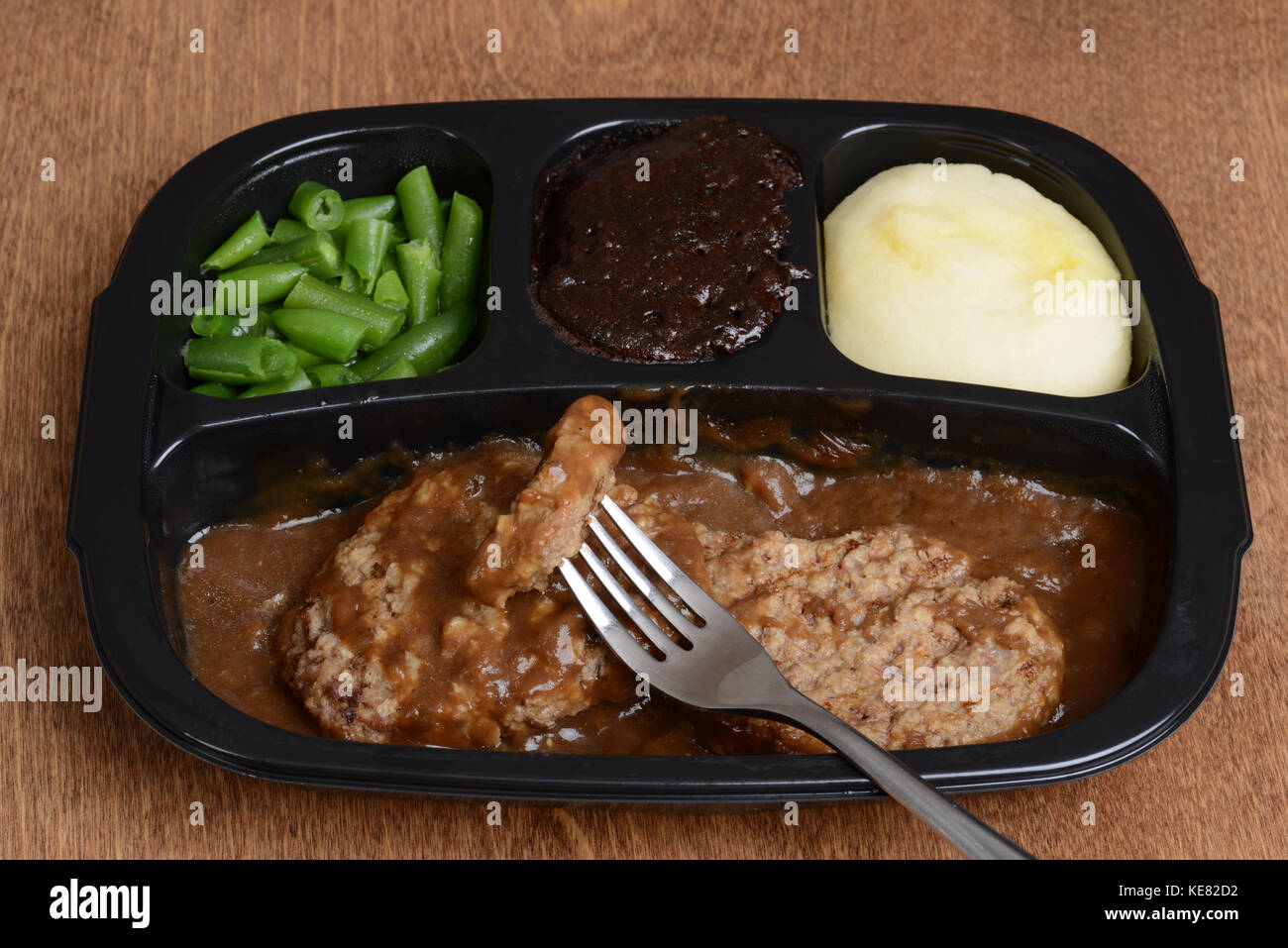 salisbury steak tv dinner with a fork Stock Photo