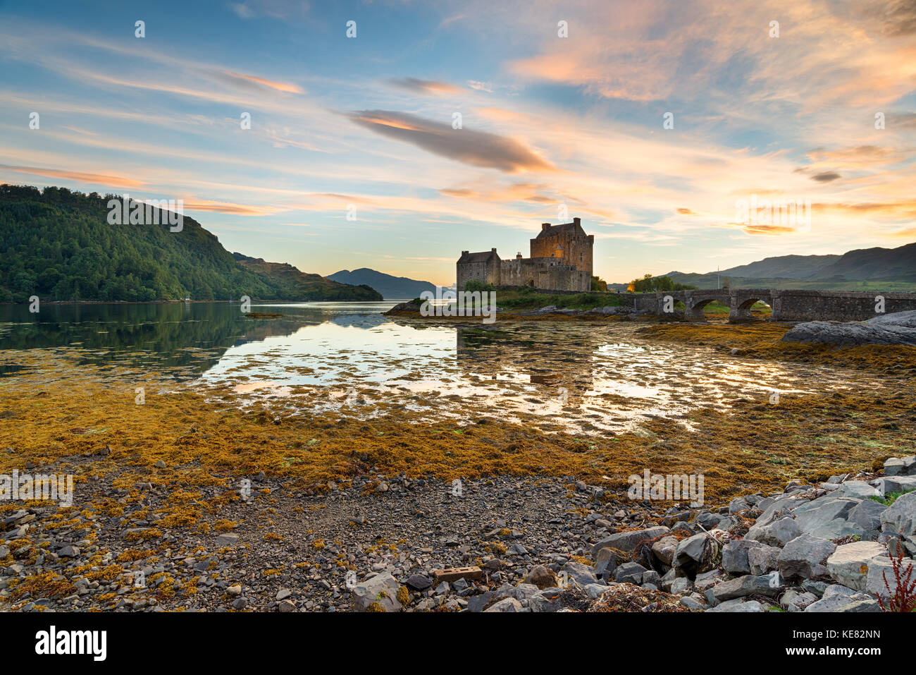 Sunset over Eilean Donan Donan Castle on the shores of Kyle of Lochalsh in the Highlands of Scotland - Stock Image