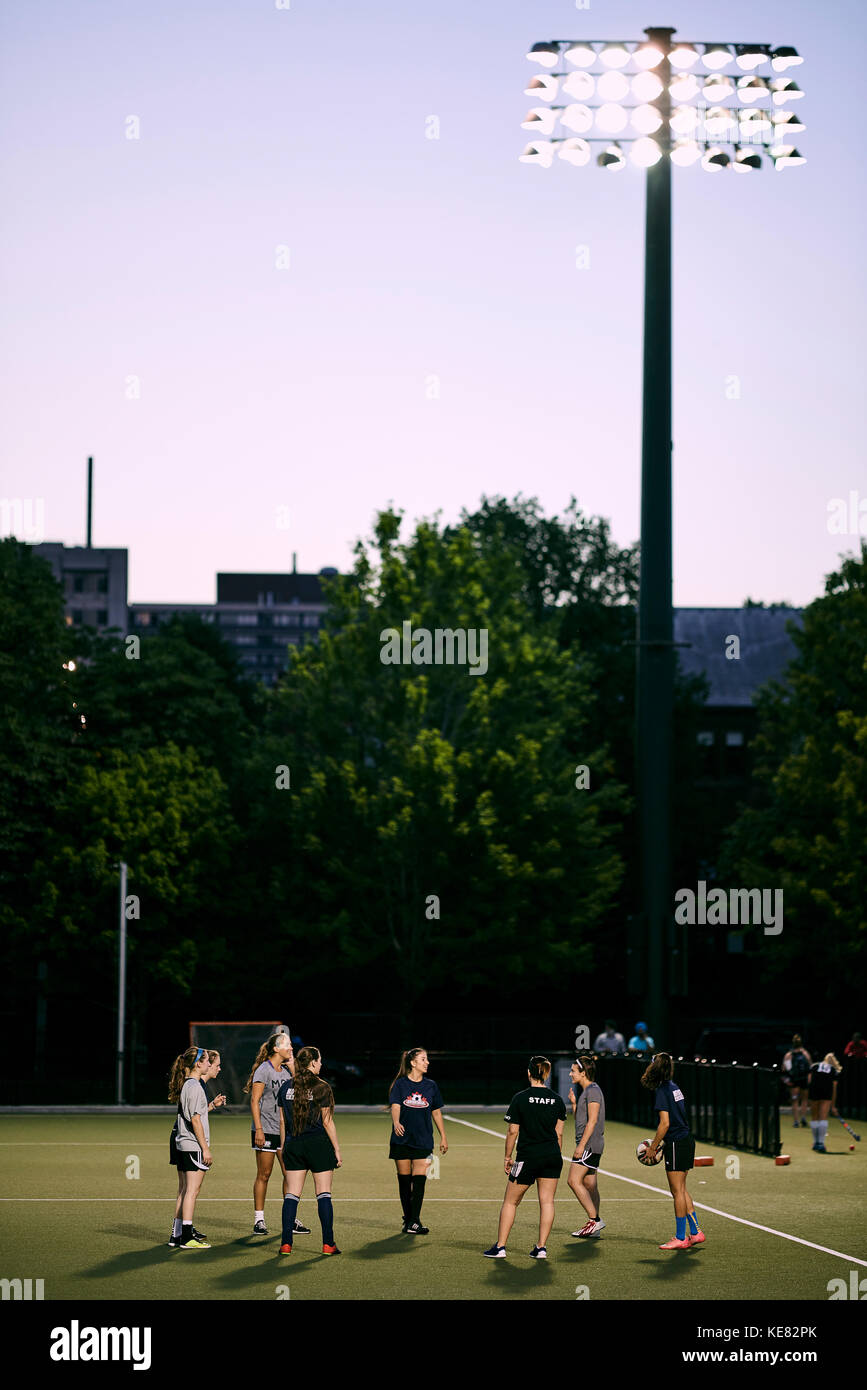 Sports Team Practice On A Field On The University Of Toronto Campus At Dusk; Toronto, Ontario, Canada Stock Photo