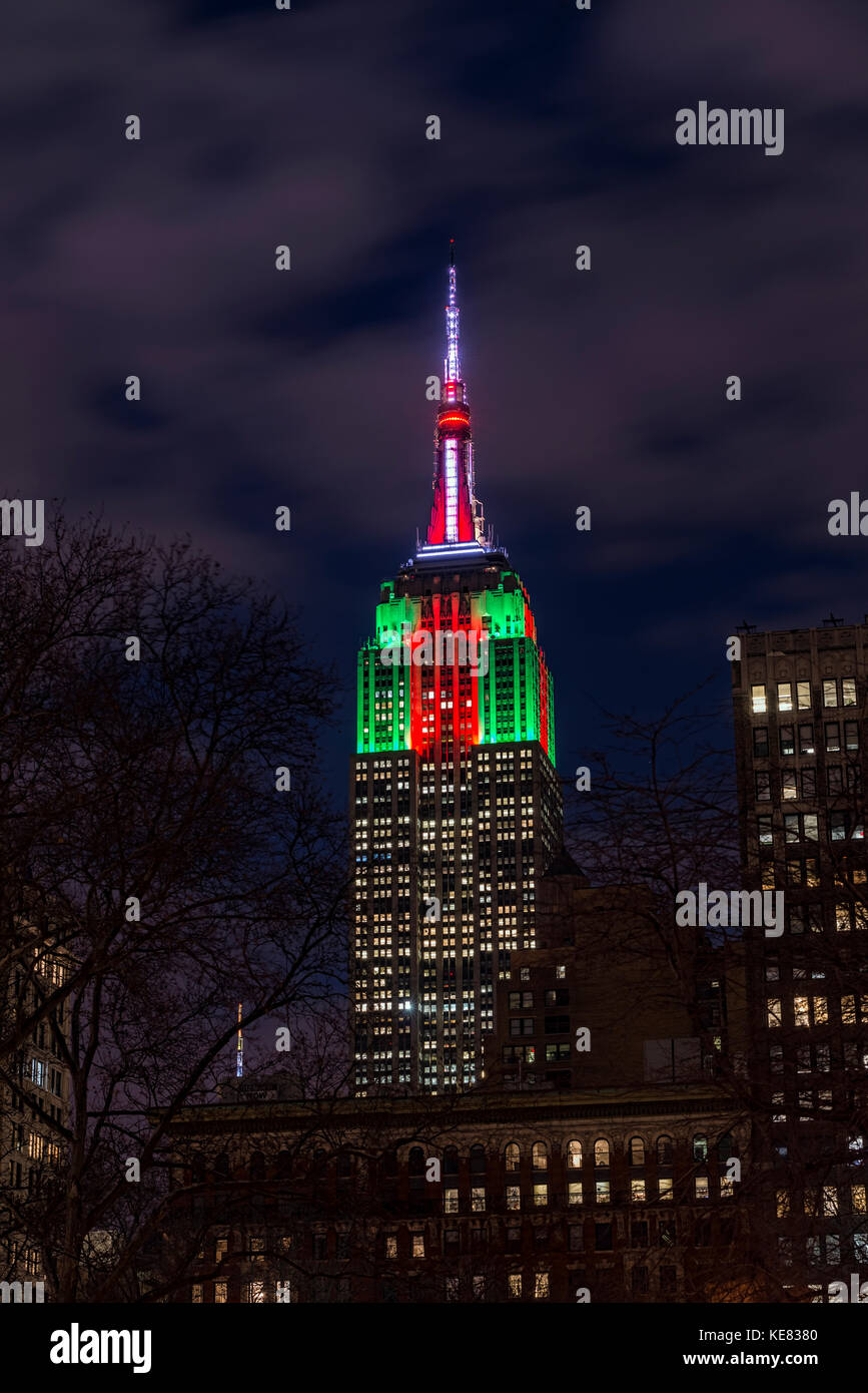 Empire State Building In Christmas Colours; New York City, New York, United States Of America Stock Photo