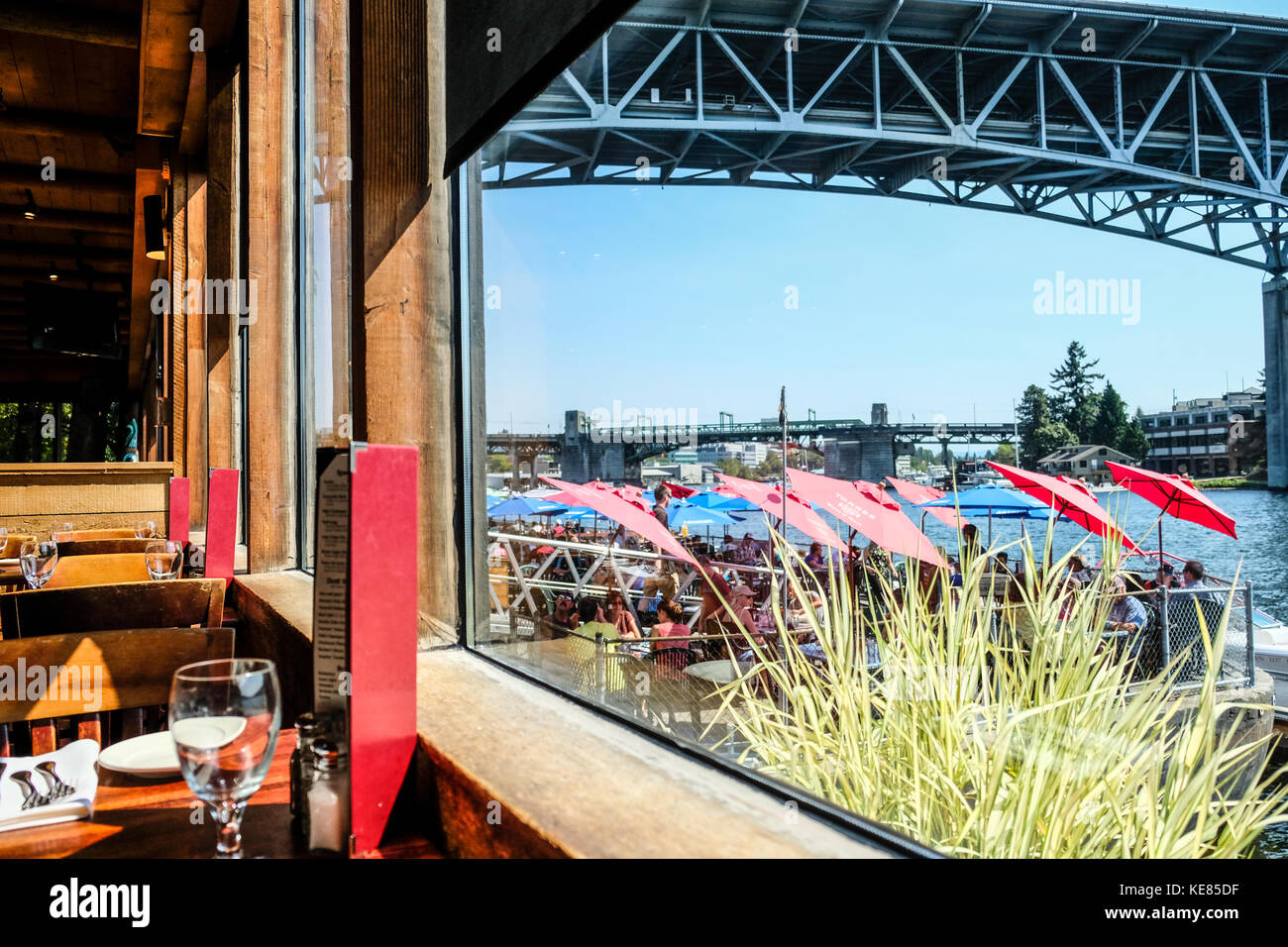 Seattle Lake Union and ship canal bridge seen through Ivar's Seafood Restaurant - Stock Image