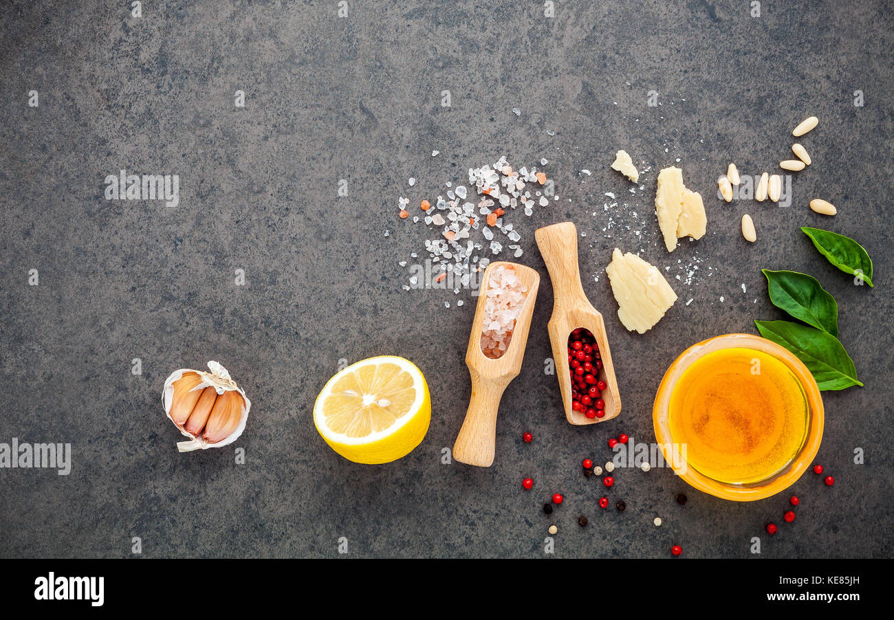 The ingredients for homemade pesto sauce basil, parmesan cheese ,garlic, olive oil , lemon ,pine nut ,pepper corn Stock Photo