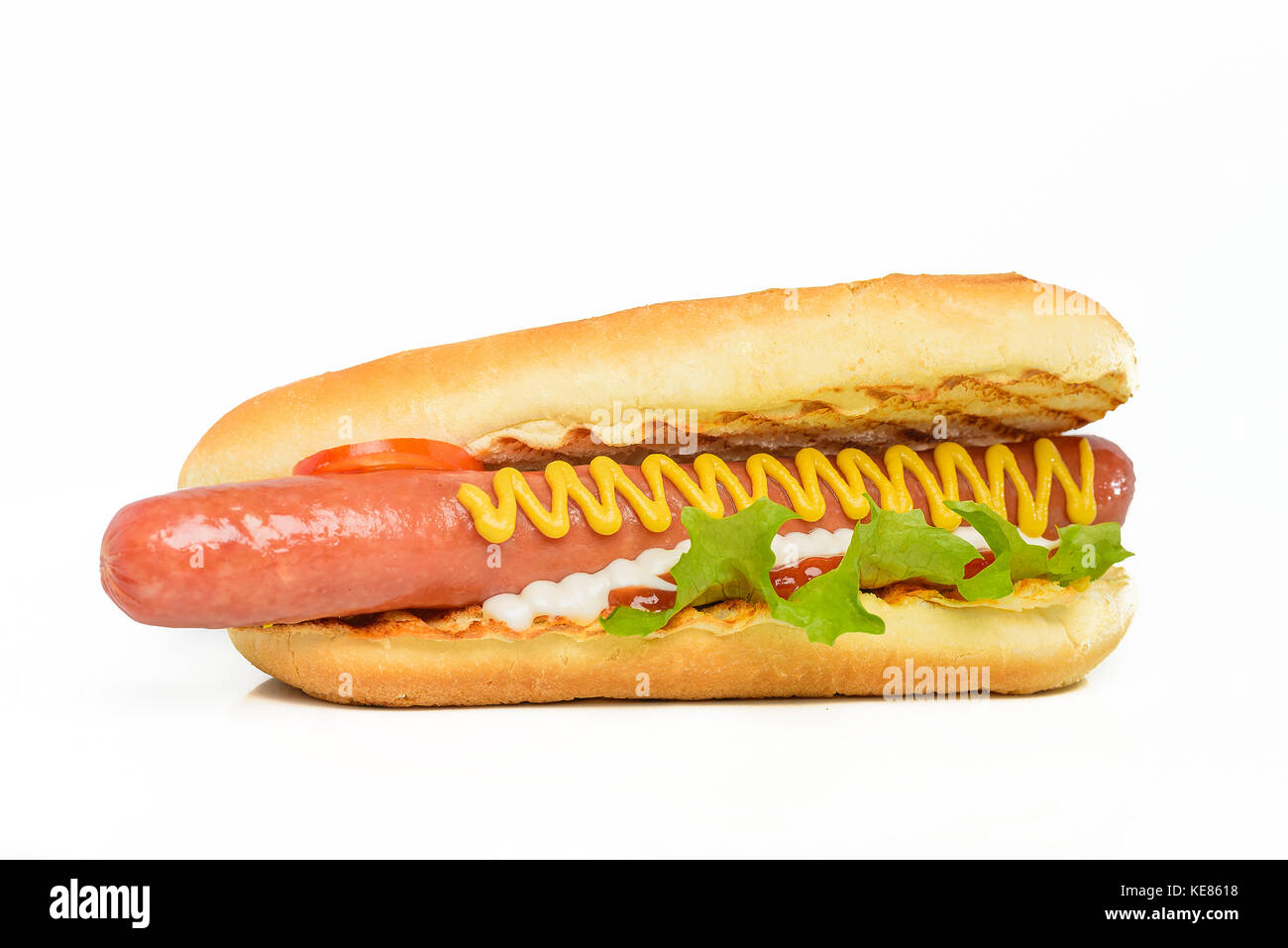 Appetizing hot dog flavored with mustard isolated on white - Stock Image