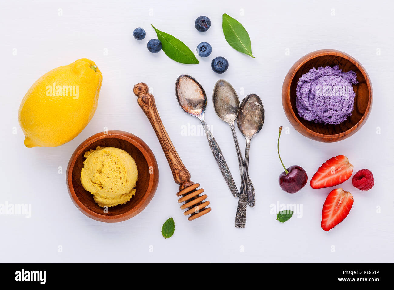 Flat lay ice cream with various fruits raspberry ,blueberry ,strawberry ,lemon and cherry  setup on white background - Stock Image
