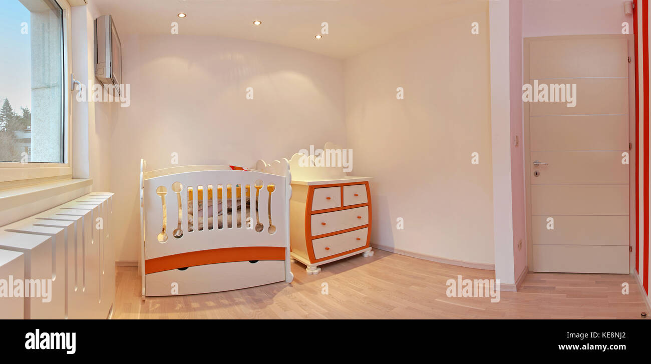 Nursery room interior newly decorated for newborn baby - Stock Image