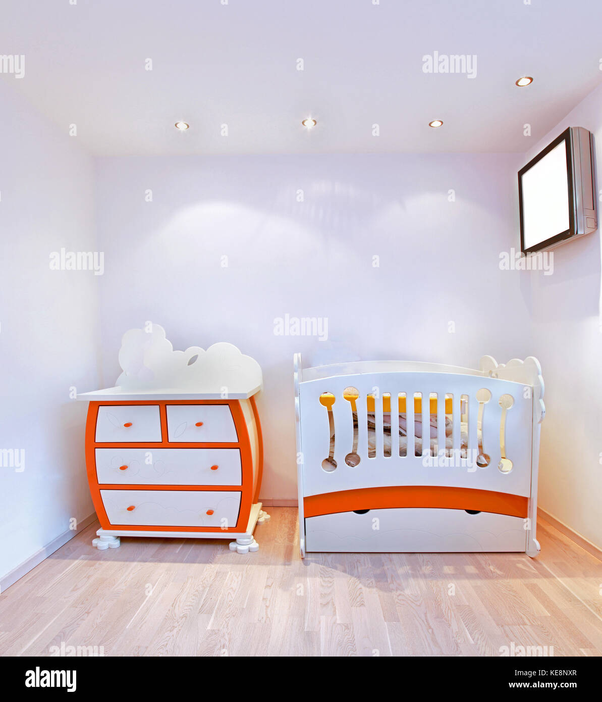 Detail of nursery room interior with small crib - Stock Image
