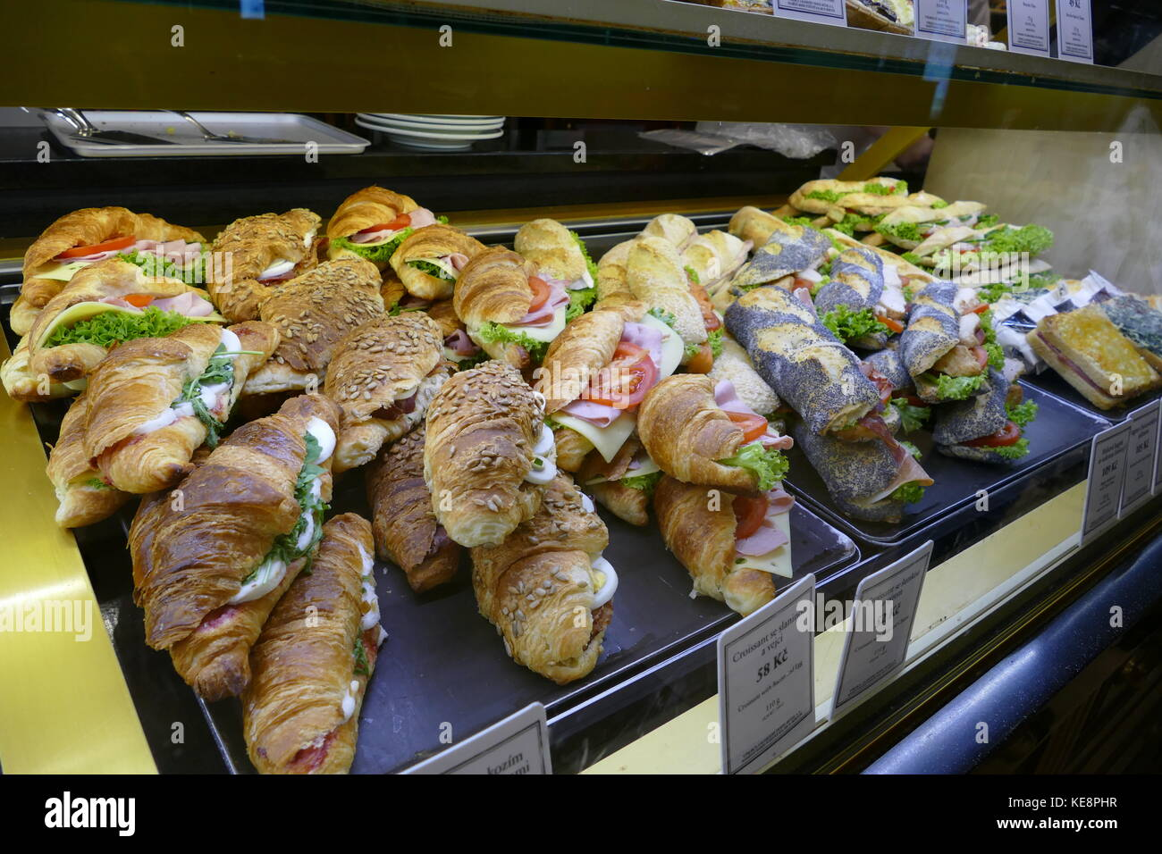 A vitrine full of stuffed croissants and baguettes in Paul's Bakery in Old Town, Prague, Czech Republic. - Stock Image