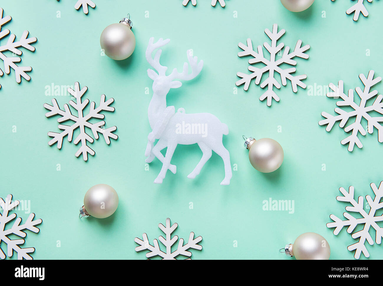 Elegant Christmas New Year Greeting Card Poster White Reindeer Snow Flakes Balls Pattern on Turquoise Blue Background. - Stock Image