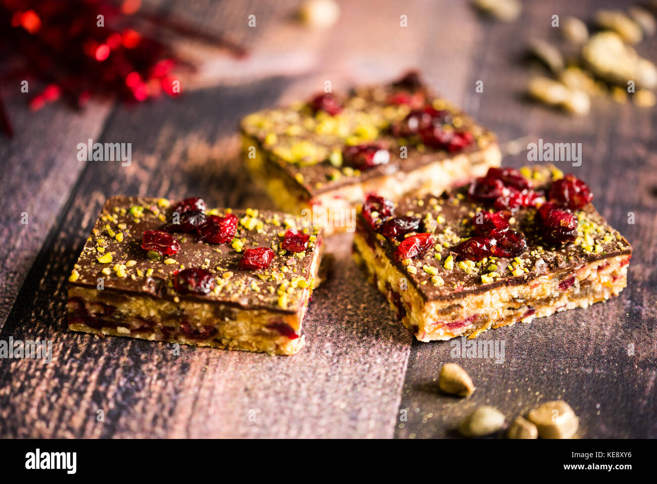 Chocolate Nancy. Pistacchio, cranberry and apricot brownie - Stock Image