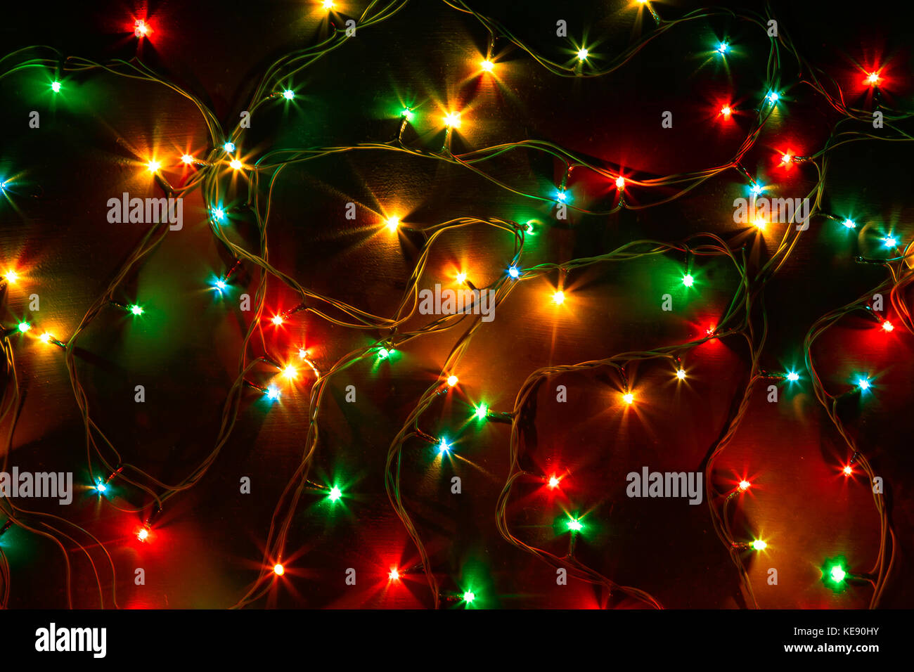 colorful christmas lights on a black background christmas and new years decor stock