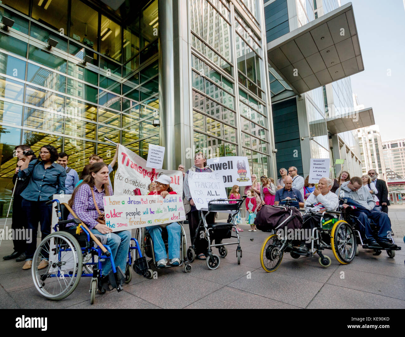 Disability campaigners protest outside the Crossrail head office building in Canary Wharf, London, UK. - Stock Image