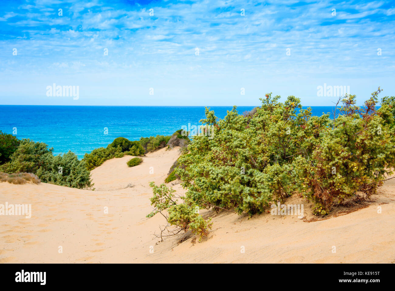 a view of the dunes of Piscinas in Sardinia, Italy, with the Mediterranean sea in the background - Stock Image