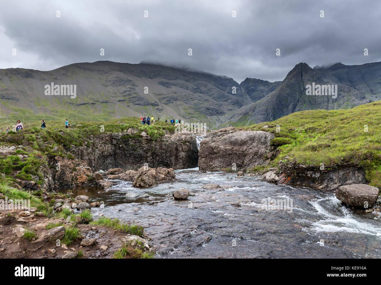 Walkers at the Fairy Pools, Glen Brittle, Isle of Skye, Highland, Scotland, UK - Stock Image