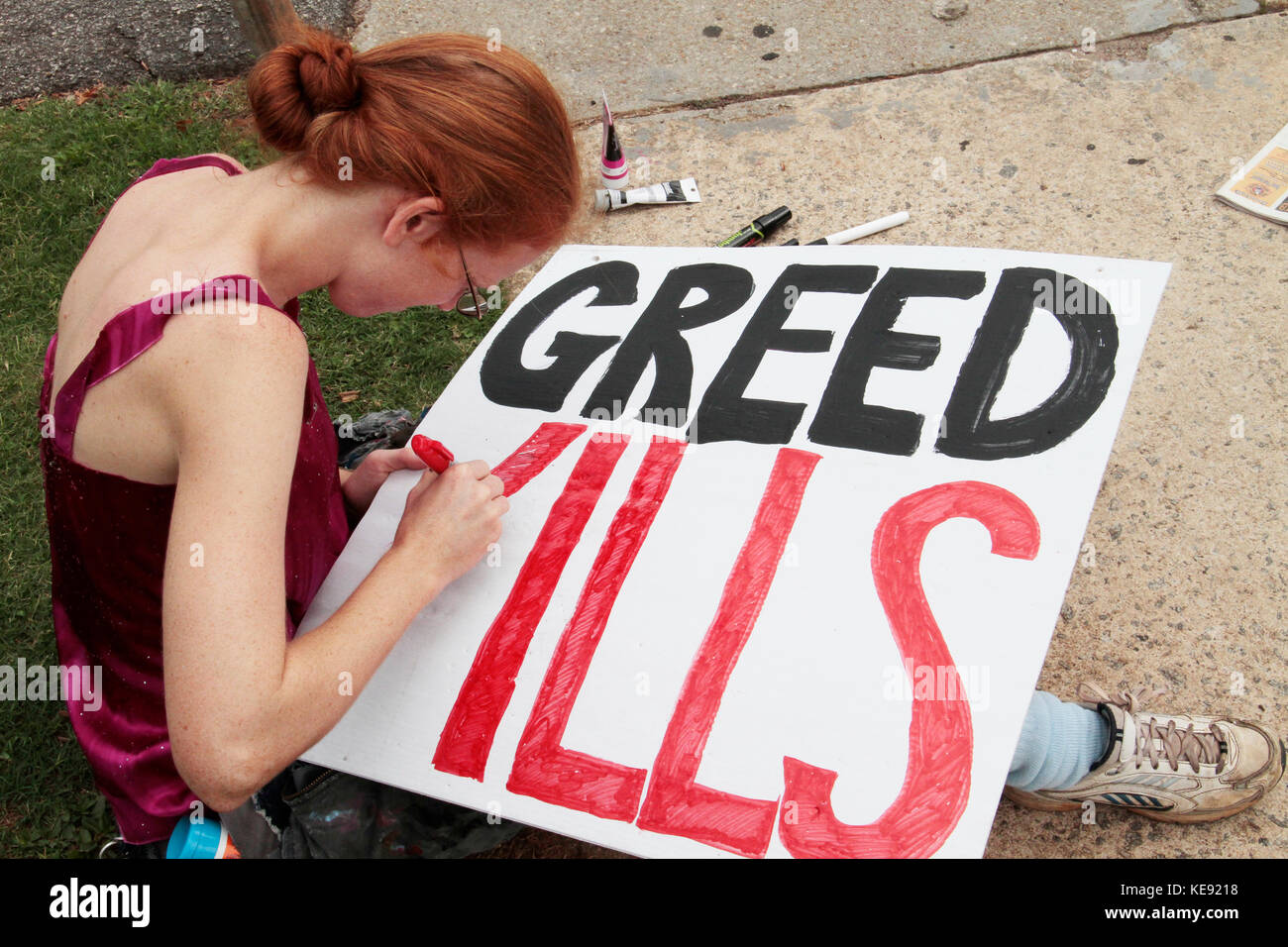 Greed Kills sign, BP protest - Stock Image