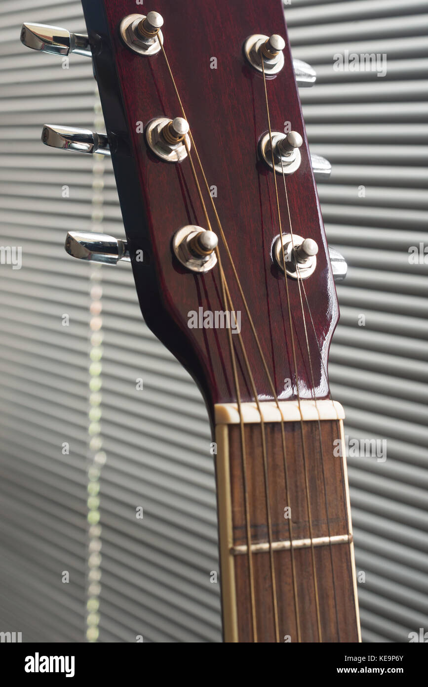 Close up to the tuning keys of an acoustic guitar - Stock Image