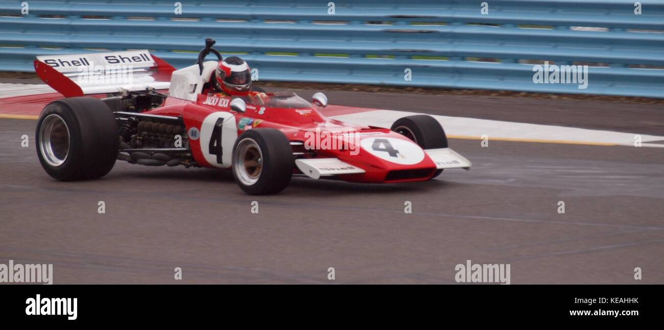 Historic Formula 1 race cars running at the GP course at Watkins Glen, New York. Two Ferraris, nos. 1 and 4 and - Stock Image