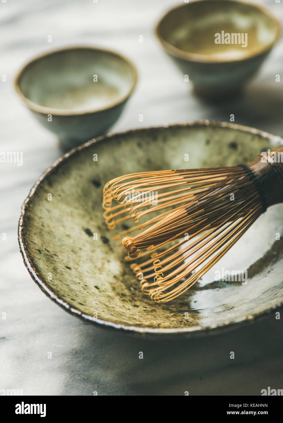 Japanese tools and bowls for brewing matcha tea, selective focus - Stock Image