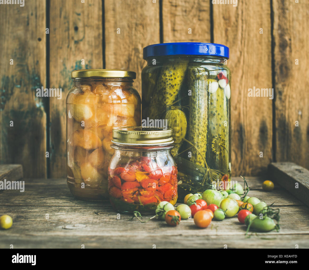 Autumn seasonal pickled vegetables and fruit in glass jars - Stock Image