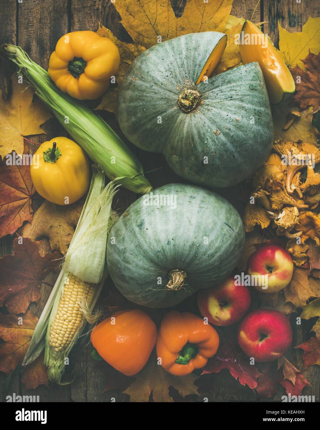 Fall colorful vegetables assortment over wooden table background - Stock Image