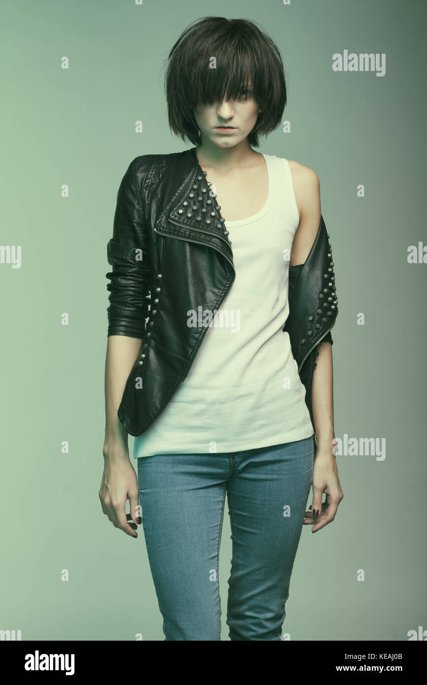 Androgyny female model in Heroin chic style. Old style tinted image - Stock Image