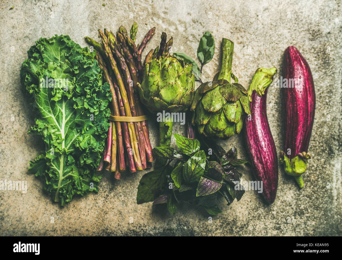Flat-lay of fresh green and purple vegetables, top view Stock Photo