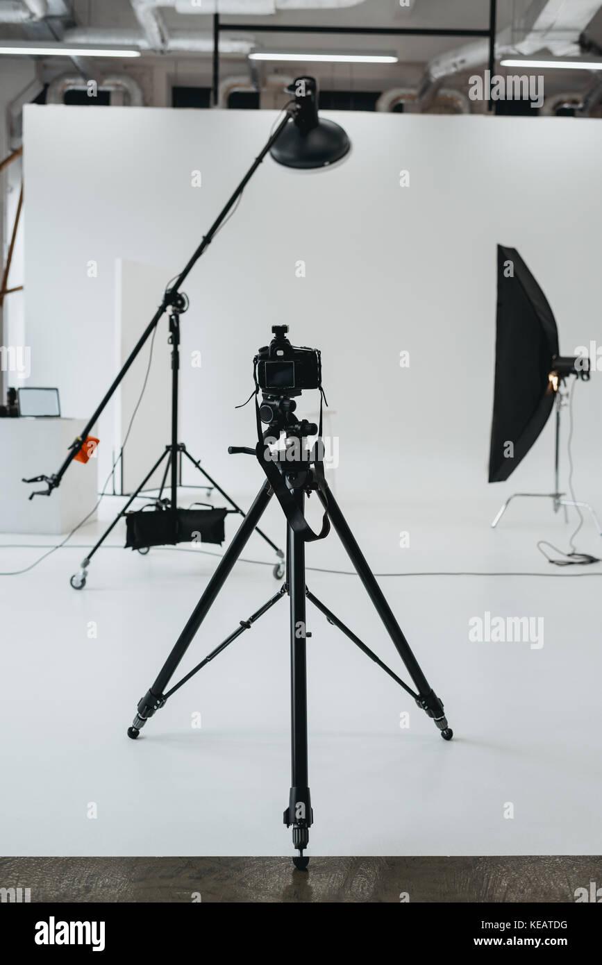 camera in photo studio with lighting equipment Stock Photo