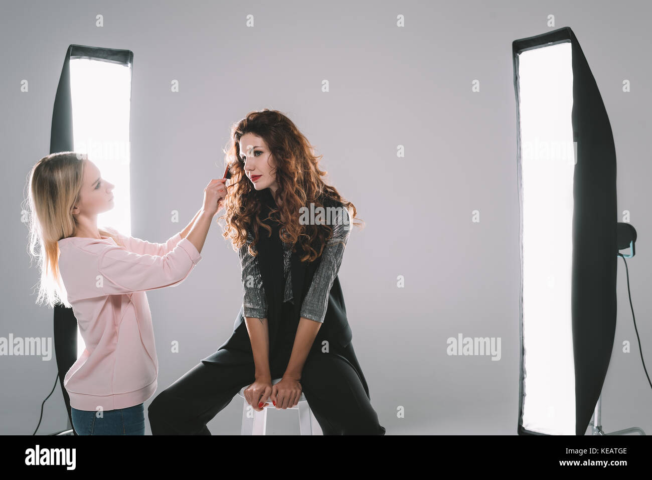 attractive model and hair stylist  - Stock Image