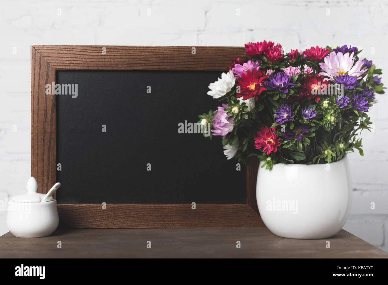 flowers in vase and blank board Stock Photo