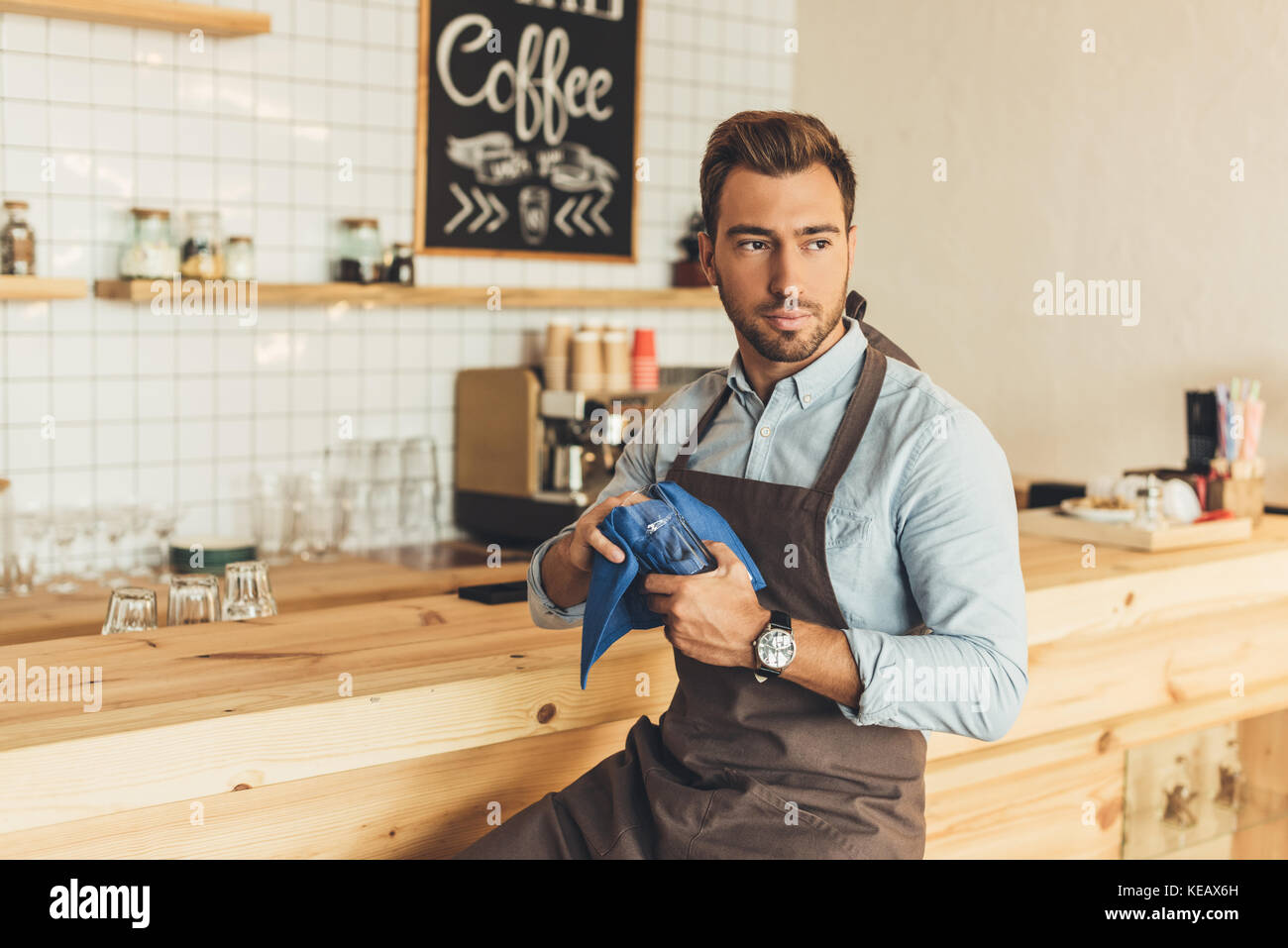 barista cleaning glassware - Stock Image