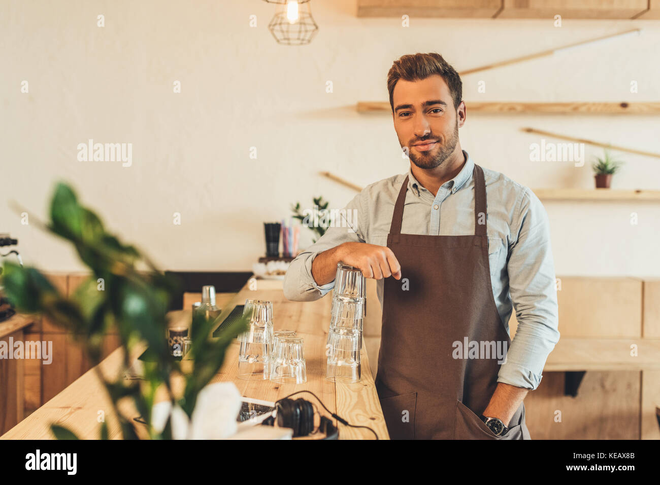 barista standing at counter - Stock Image