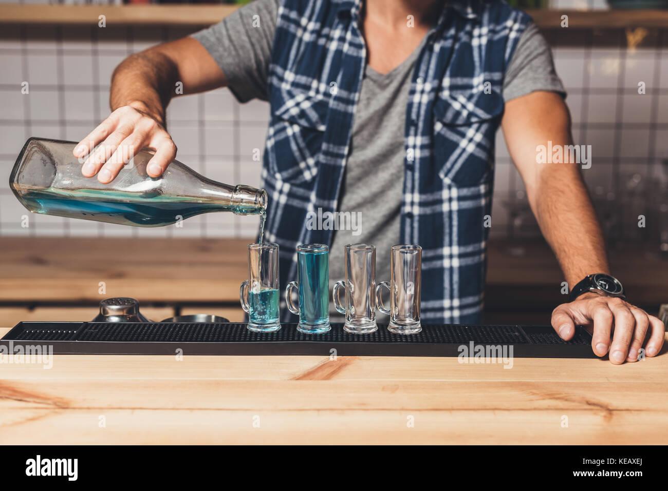 barman making alcohol shots - Stock Image
