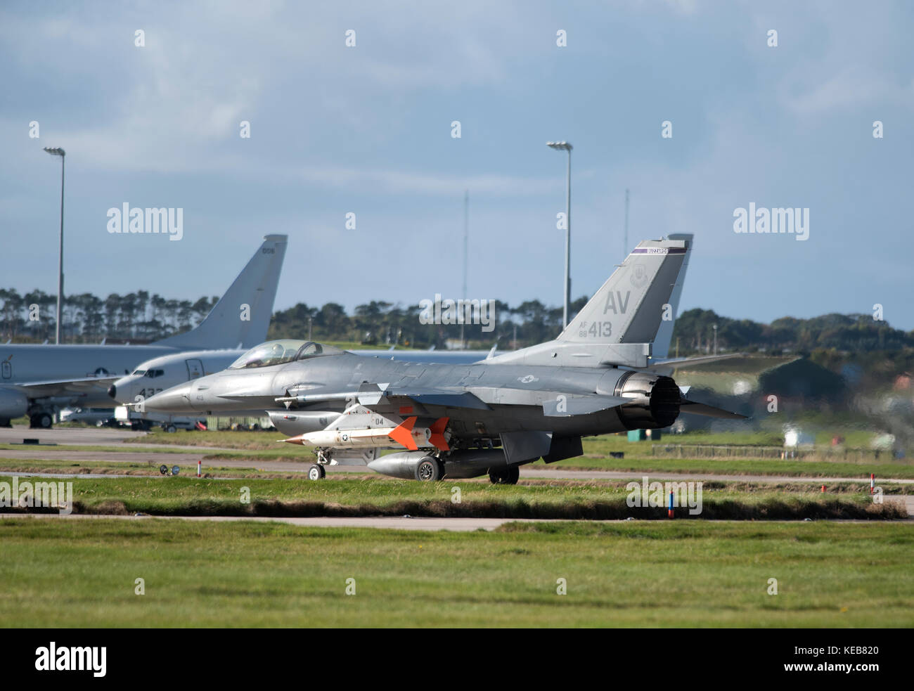 A USAF F16 fighter jet on the 2017 joint Warrio exercise preparing to depart RAF Lossiemouth, Morayshire Scotland. - Stock Image
